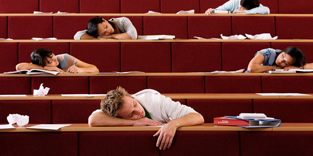 Students sleeping in lecture theatre